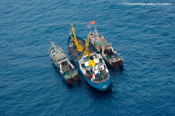 A photo of a Belize-flagged vessel engaging in the transshipment of illegal catch in 2006.